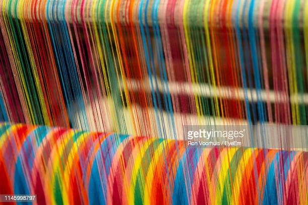 full frame shot of multi colored threads in factory - textile industry stock pictures, royalty-free photos & images