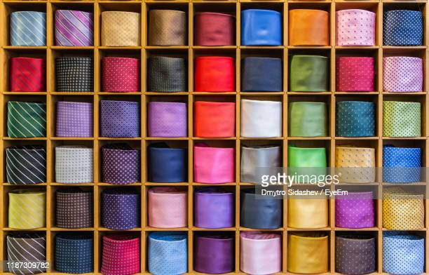 full frame shot of multi colored tie in shelf - purple suit stock pictures, royalty-free photos & images