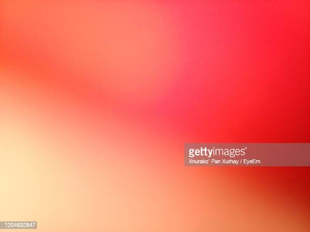 full frame shot of multi colored wall - orange farbe stock-fotos und bilder