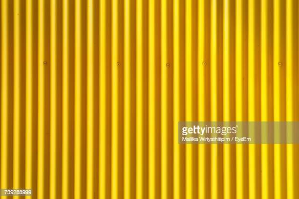 full frame shot of multi colored yellow wall - corrugated iron stock photos and pictures