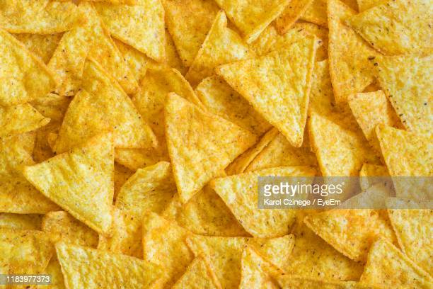 full frame shot of nacho chips - crunchy stock pictures, royalty-free photos & images