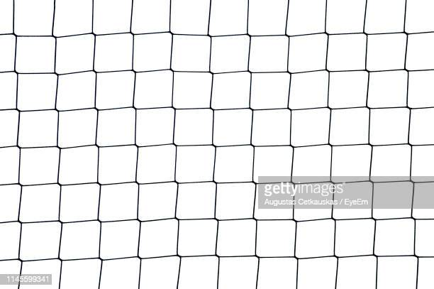 full frame shot of net against white background - netting stock pictures, royalty-free photos & images