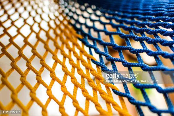 full frame shot of netting - woven stock pictures, royalty-free photos & images