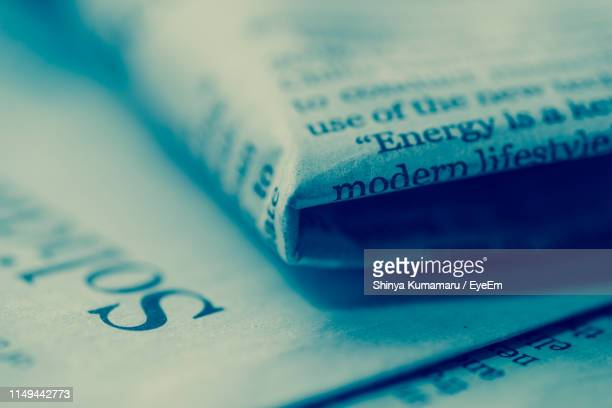 full frame shot of newspapers - western script stock pictures, royalty-free photos & images