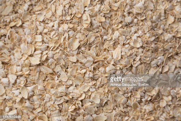 full frame shot of oat flakes - oatmeal stock pictures, royalty-free photos & images