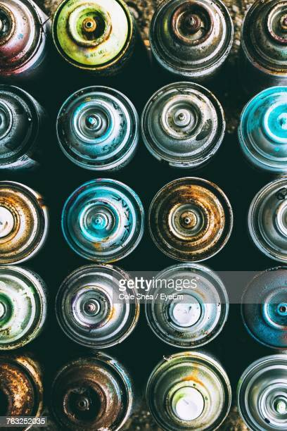 Full Frame Shot Of Old Aerosol Cans