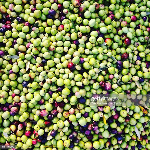 full frame shot of olives - green olive fruit stock pictures, royalty-free photos & images