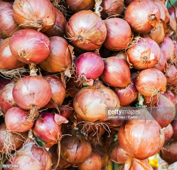 Full Frame Shot Of Onions For Sale At Market
