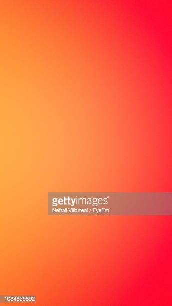 full frame shot of orange background - gradient stock pictures, royalty-free photos & images