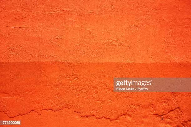 full frame shot of orange wall - orange color stock pictures, royalty-free photos & images