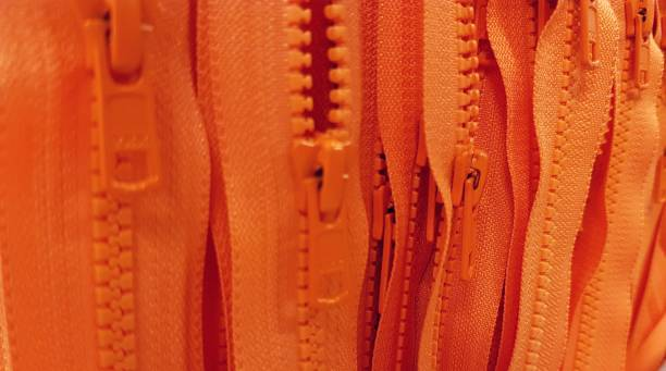 Full Frame Shot Of Orange Zips