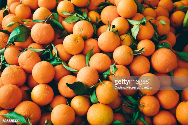 full frame shot of oranges - arancione foto e immagini stock
