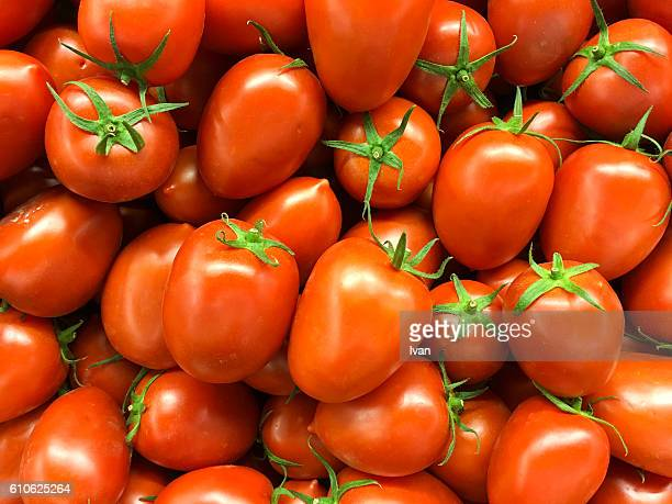 full frame shot of organic vine ripened cherry tomatoes in market - ripe stock pictures, royalty-free photos & images