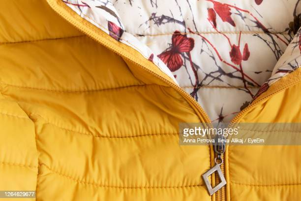 full frame shot of padded jacket - yellow coat stock pictures, royalty-free photos & images