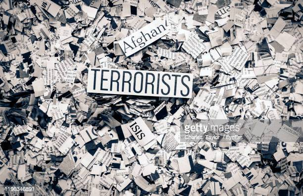 full frame shot of paper with text - terrorism stock pictures, royalty-free photos & images