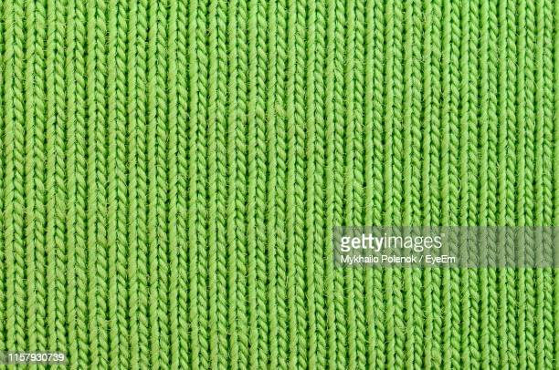 full frame shot of patterned fabric - knitted stock pictures, royalty-free photos & images