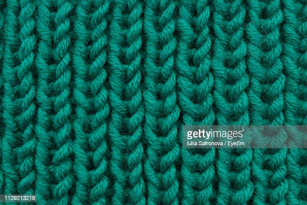 full frame shot of patterned sweater - knitted stock pictures, royalty-free photos & images
