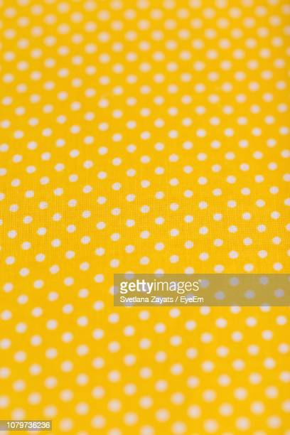 full frame shot of patterned textile - polka dot stock pictures, royalty-free photos & images