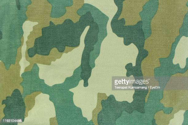 full frame shot of patterned textile - camouflage stock pictures, royalty-free photos & images