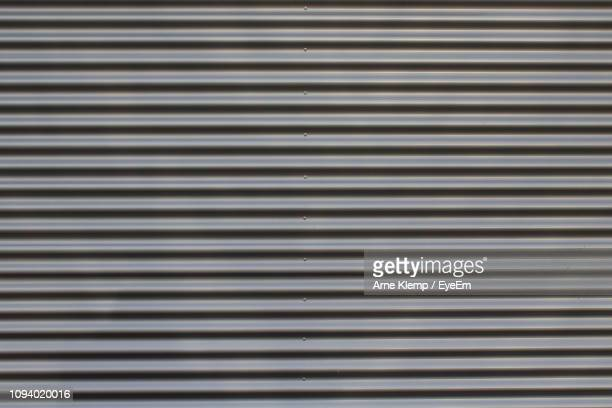 full frame shot of patterned wall - sheet metal stock pictures, royalty-free photos & images
