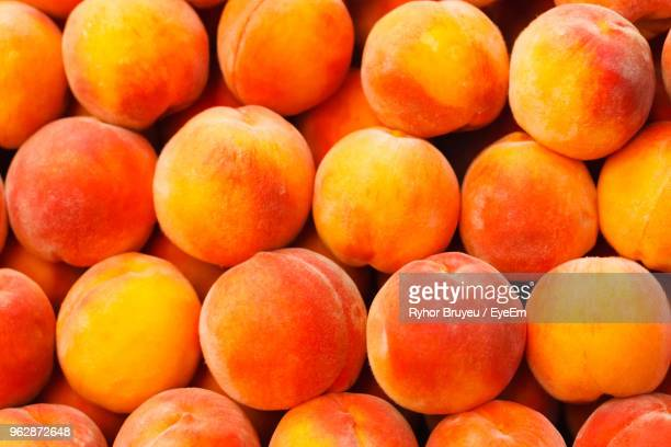 full frame shot of peaches for sale at market - peach stock photos and pictures