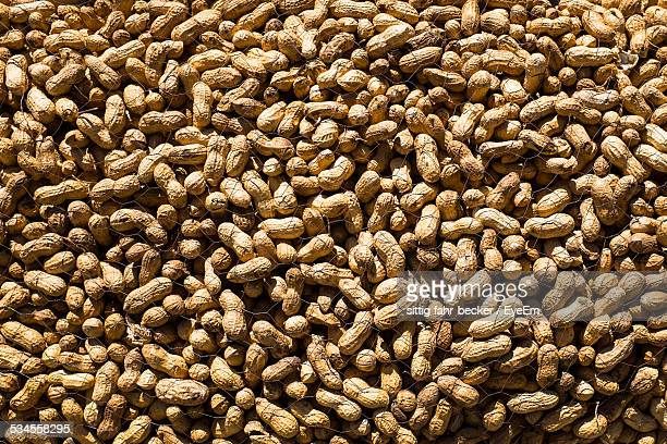 full frame shot of peanuts - nutshell stock photos and pictures