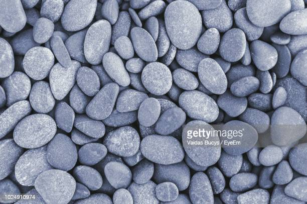 full frame shot of pebbles at beach - pebble stock pictures, royalty-free photos & images