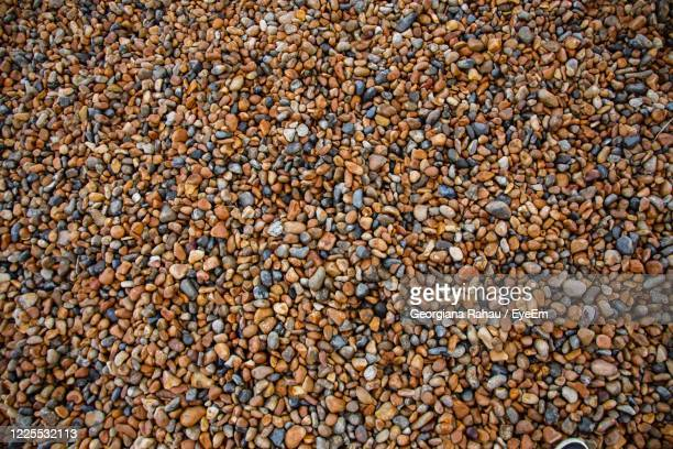 full frame shot of pebbles on beach - brighton beach england stock pictures, royalty-free photos & images