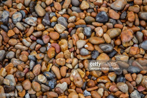 full frame shot of pebbles - brighton beach england stock pictures, royalty-free photos & images