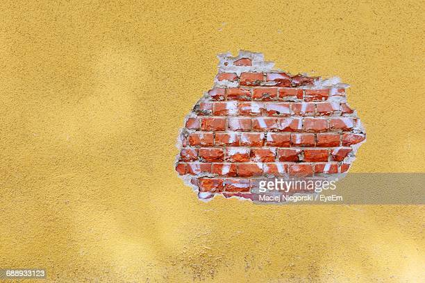 Full Frame Shot Of Peeled Off Brick Wall