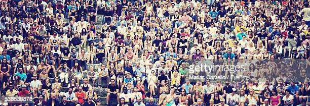 full frame shot of people sitting at stadium - abundance stock pictures, royalty-free photos & images