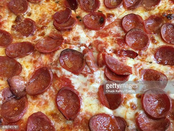 full frame shot of pepperoni pizza - pepperoni pizza stock photos and pictures