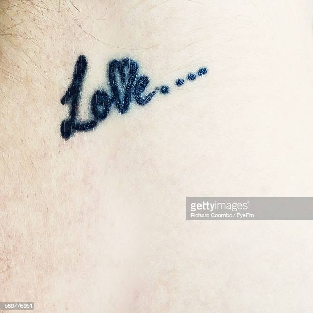 Full Frame Shot Of Person With Love Text Tattoo
