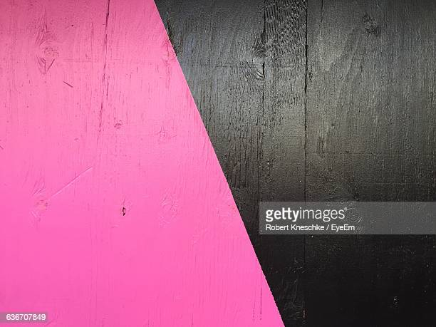 Full Frame Shot Of Pink And Black Wooden Wall