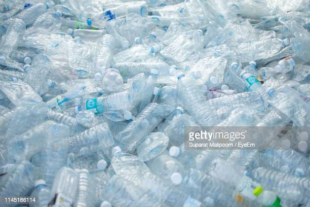 full frame shot of plastic bottles - plastic stockfoto's en -beelden