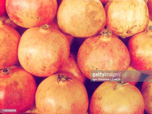 full frame shot of pomegranates for sale - igor golovniov stock pictures, royalty-free photos & images