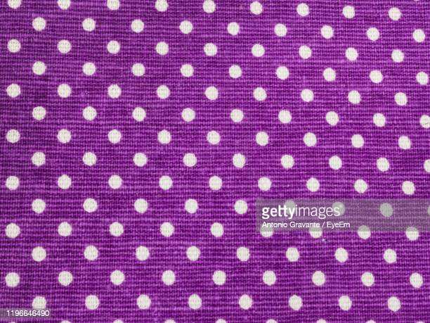 full frame shot of purple textile - polka dot stock pictures, royalty-free photos & images