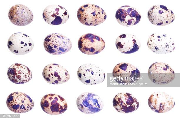 Full Frame Shot Of Quail Eggs Against White Background