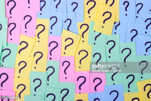 full frame shot of question marks on colorful adhesive notes - questions stock pictures, royalty-free photos & images