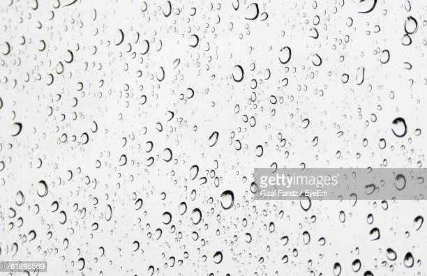 Full Frame Shot Of Raindrops On Water Drops