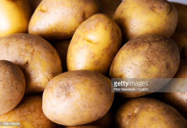 full frame shot of raw potatoes - raw potato stock pictures, royalty-free photos & images