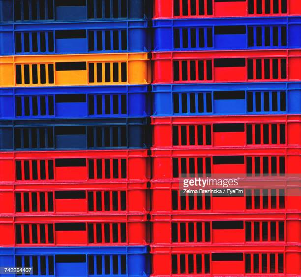 Full Frame Shot Of Red And Blue Crates For Sale At Market
