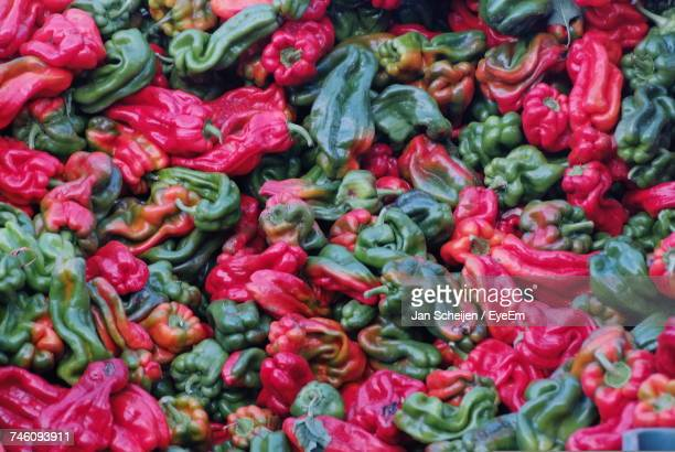 Full Frame Shot Of Red And Green Bell Peppers For Sale At Market Stall