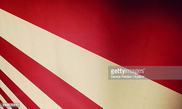 Full Frame Shot Of Red And White Striped On Wall