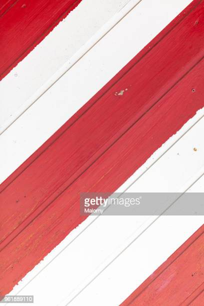 Full frame shot of red and white striped wooden wall or window shutter.