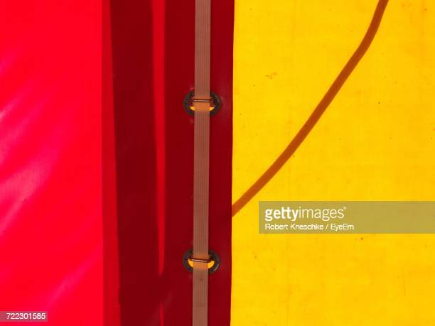 Full Frame Shot Of Red And Yellow Tent
