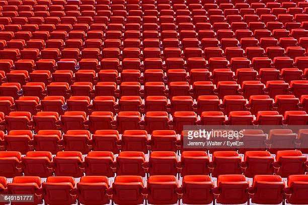 full frame shot of red bleachers - empty bleachers stockfoto's en -beelden