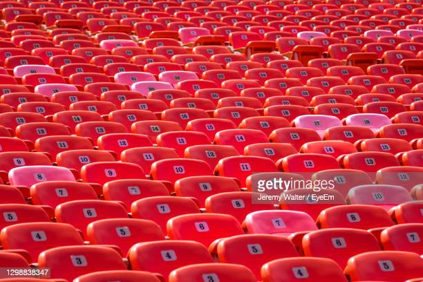 full frame shot of red chairs in empty stadium - eyeem jeremy walter stock pictures, royalty-free photos & images