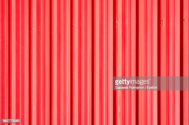 full frame shot of red corrugated iron - corrugated iron stock photos and pictures
