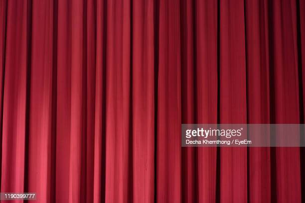 full frame shot of red curtain - curtain stock pictures, royalty-free photos & images
